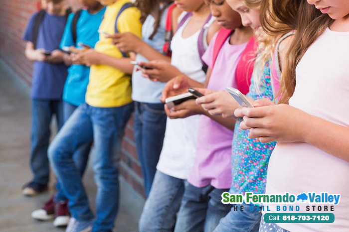 Should Cellphones be Banned by Law in Schools?